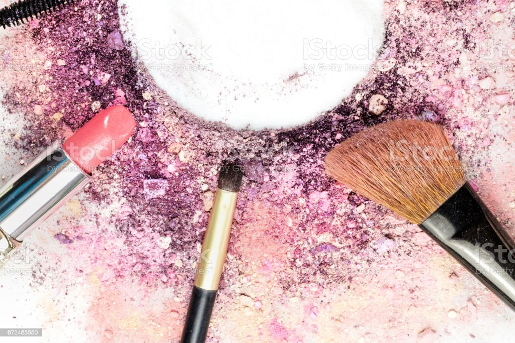 Makeup brush, lipstick, and pencil with powder and copyspace stock photo