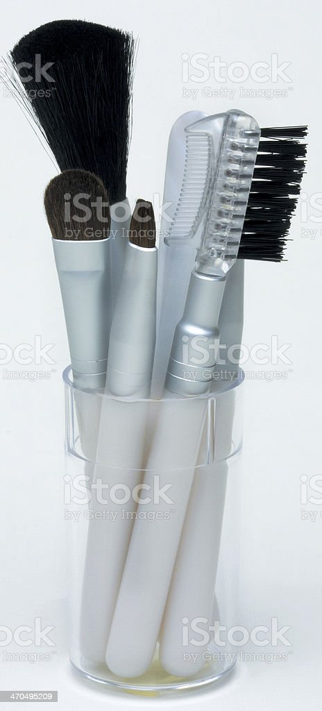 Makeup brush set in container stock photo