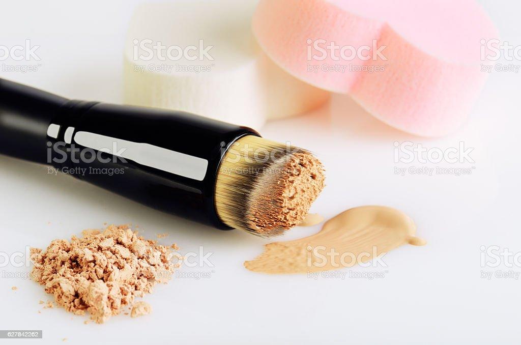 make-up brush, sponges, smear makeup base and face powder stock photo