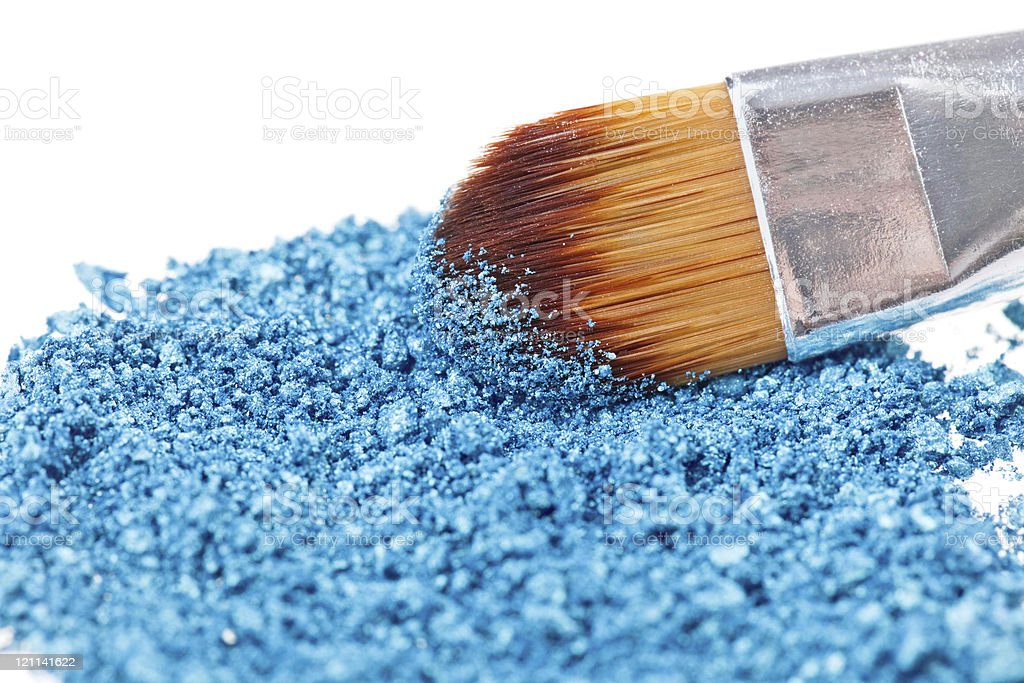 Makeup brush with blue crushed eye shadow royalty-free stock photo