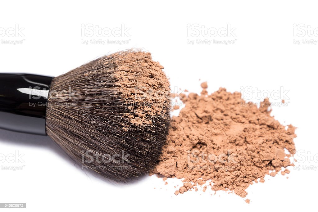 Makeup brush with loose cosmetic powder on white background stock photo