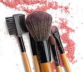 makeup brushes and broken color eye shadows
