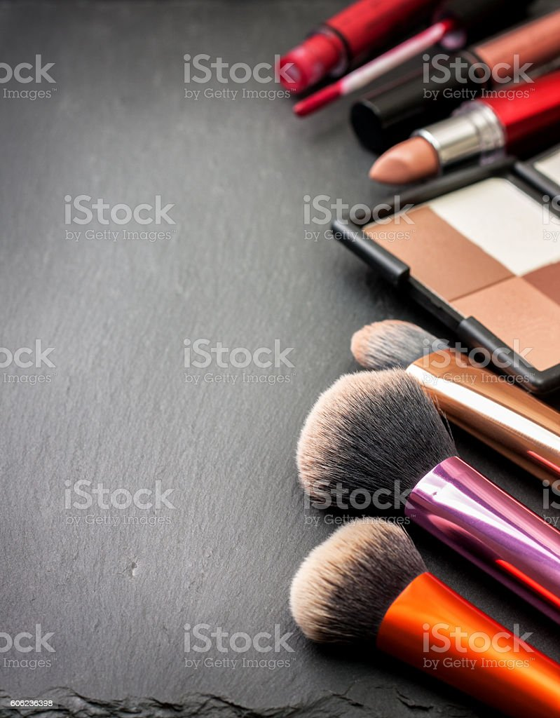makeup brushes and cosmetics stock photo