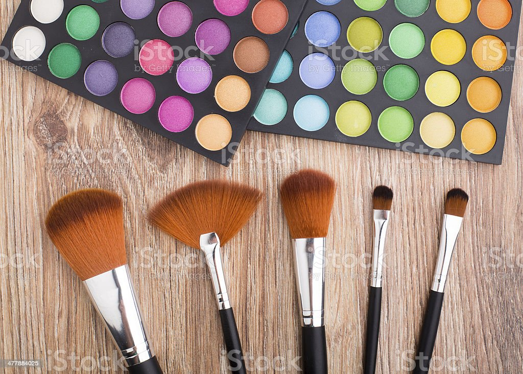 Makeup brushes and eye shadows royalty-free stock photo