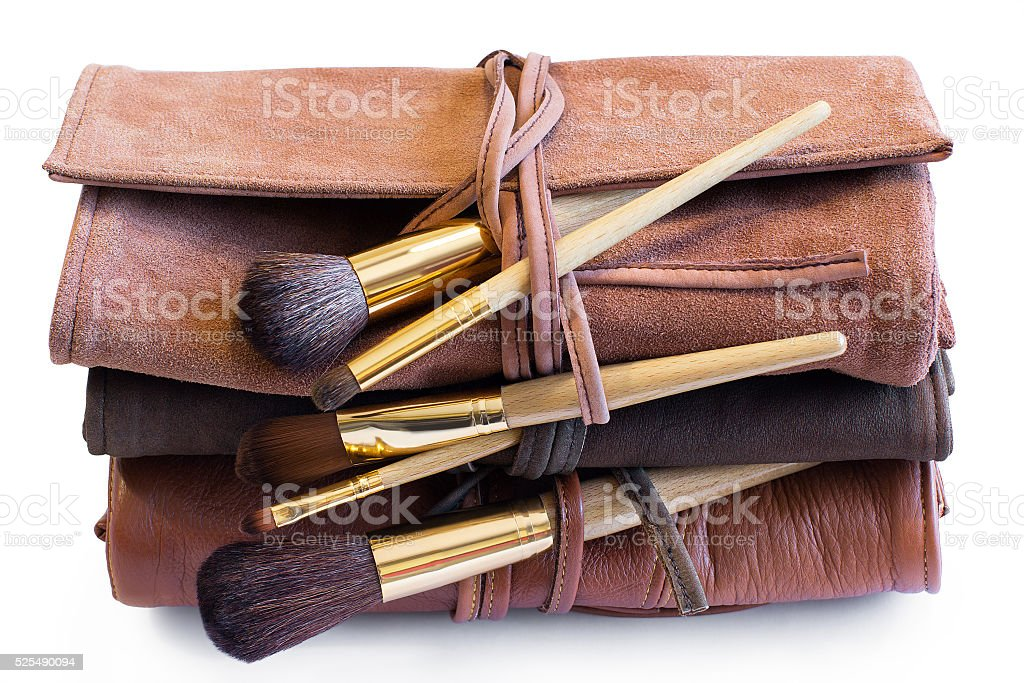 Makeup Brushes in a colored leather coveres stock photo