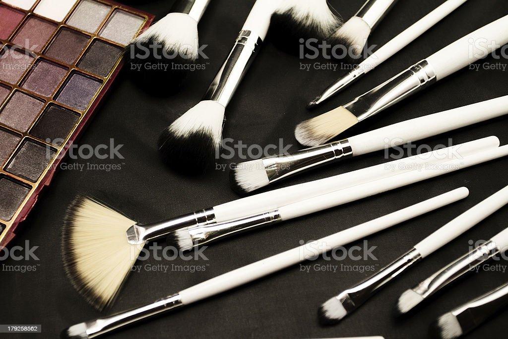 Make-up brushes in dark background royalty-free stock photo