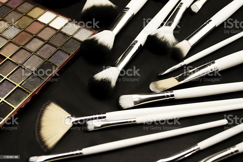 Make-up brushes in dark background royalty-free stock photo