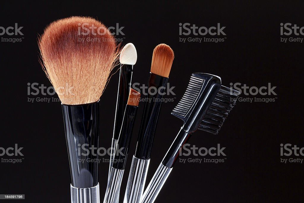 Make-up brushes on black background royalty-free stock photo