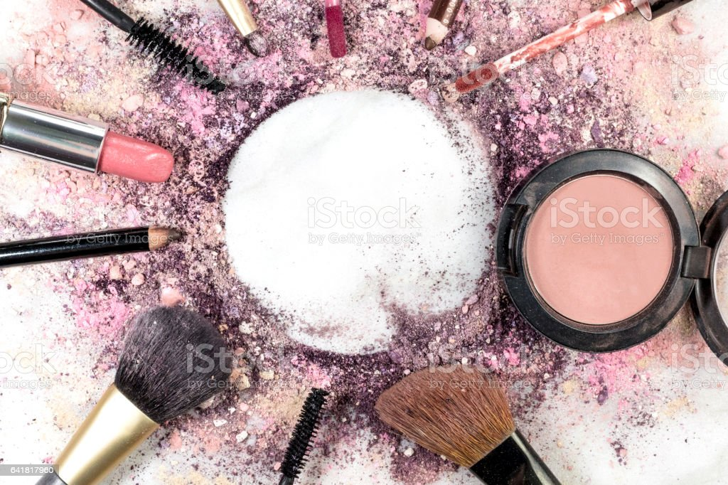 Makeup brushes, pencil, lipstick etc forming frame for copyspac stock photo