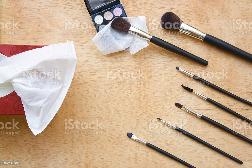 Makeup brushes set on a wooden surface stock photo