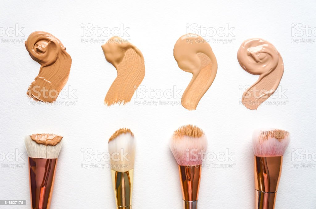 Makeup brushes with smeared liquid foundation stock photo