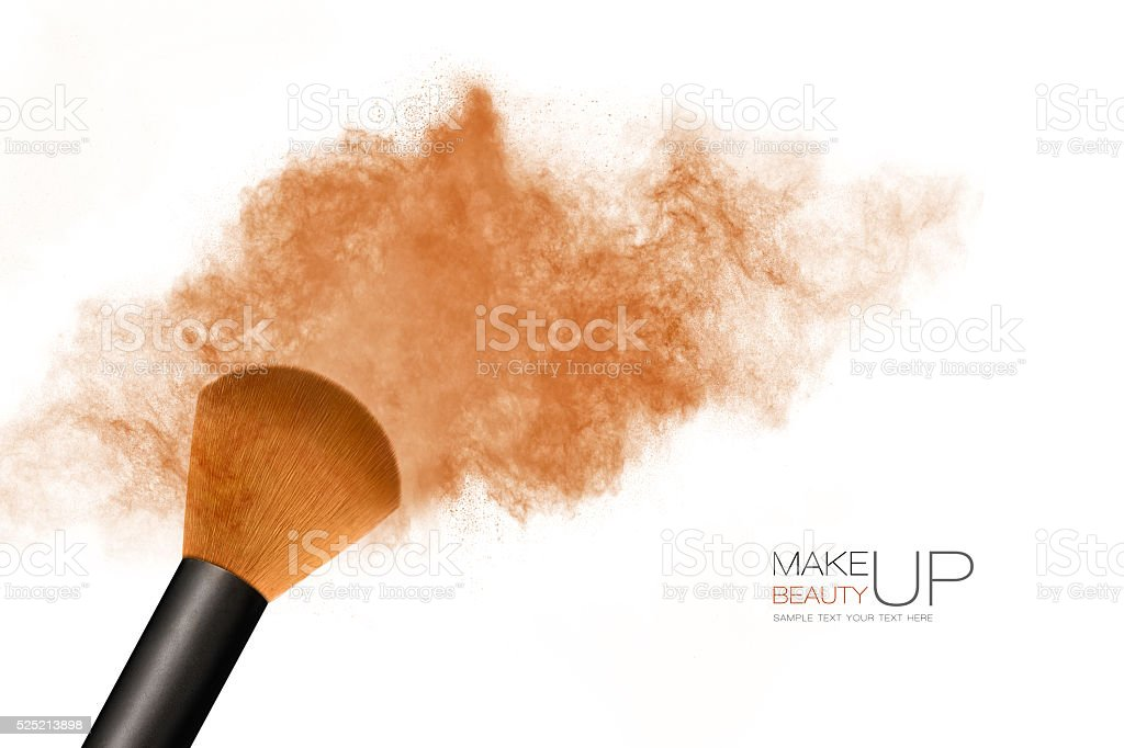 Makeup concept. Cosmetic brush with bronzing powder explosion stock photo