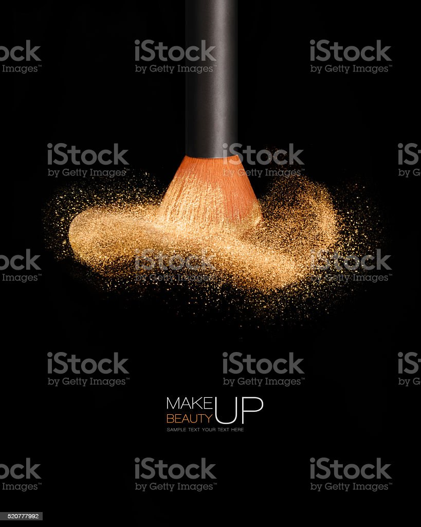 Makeup concept. Cosmetics brush with glowing face powder stock photo