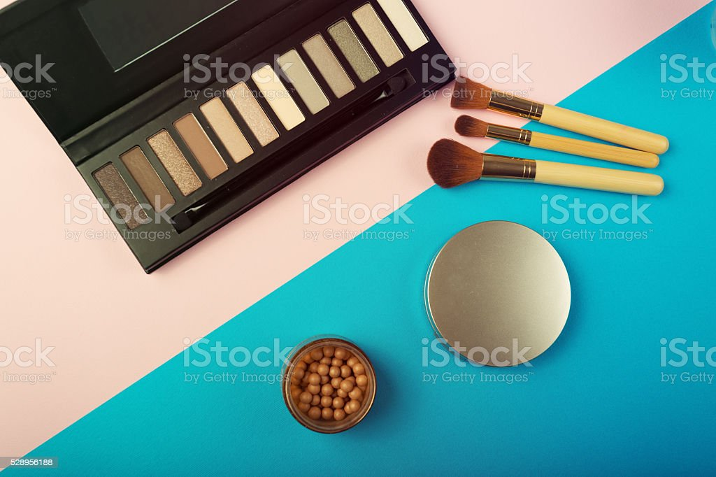Makeup essentials on a pink background stock photo