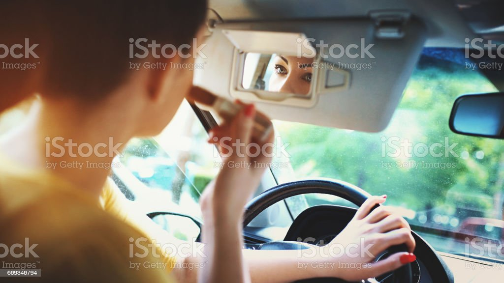 Makeup in a car. stock photo