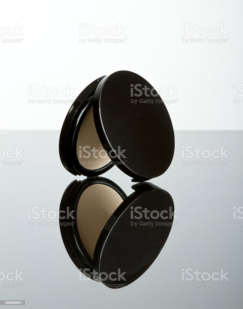 Makeup pressed powder foundation compact stock photo