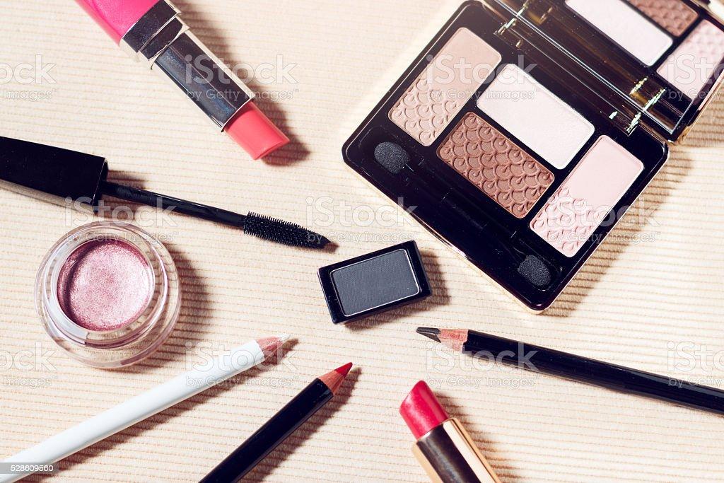 Makeup set of beige, brown, pink eyeshadows, eye pencil, lip pencil,...