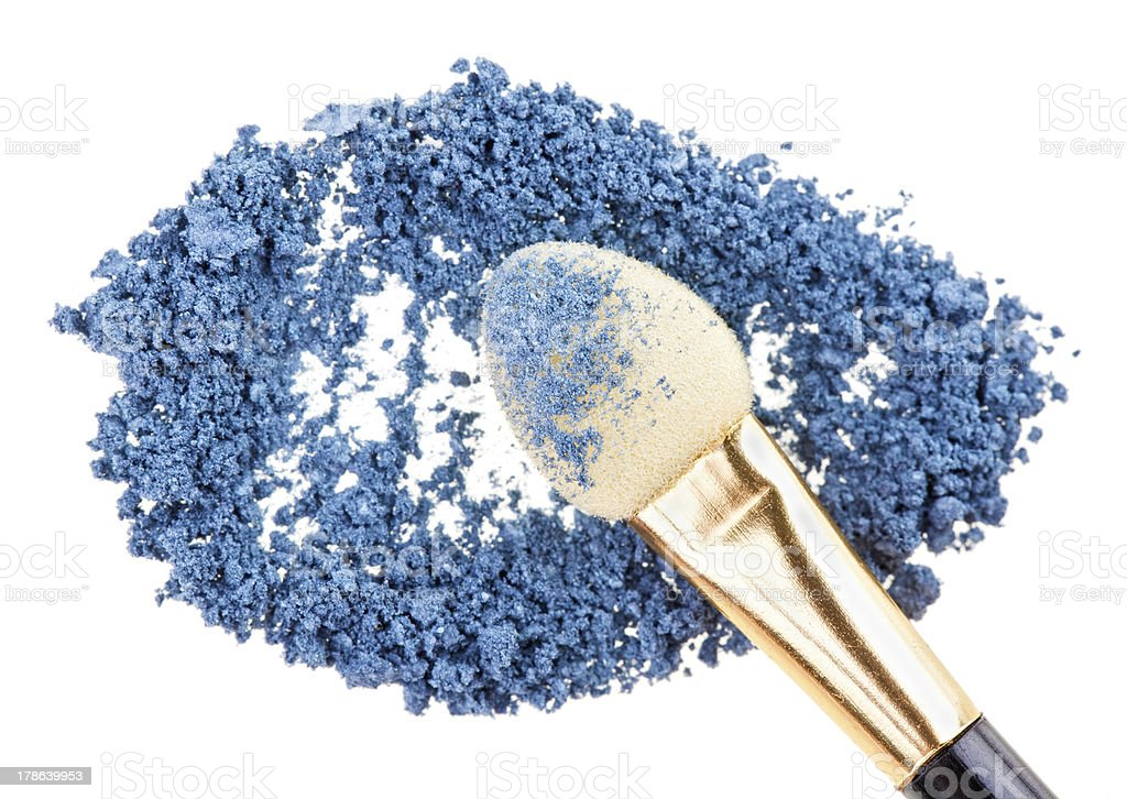 Makeup sponge with blue crushed eye shadow, isolated on white royalty-free stock photo