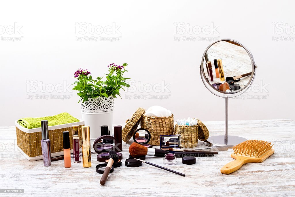 Make-up spread over a vanity with a mirror stock photo