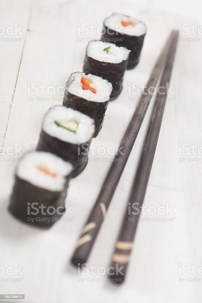 Maki Sushi with Chopsticks royalty-free stock photo