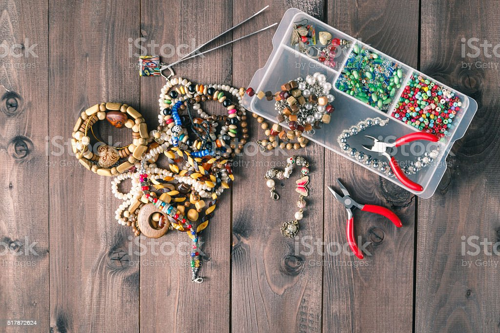 Making a beads necklace stock photo