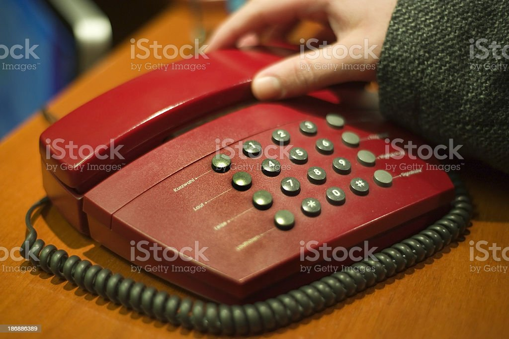 Making a call with red phone stock photo