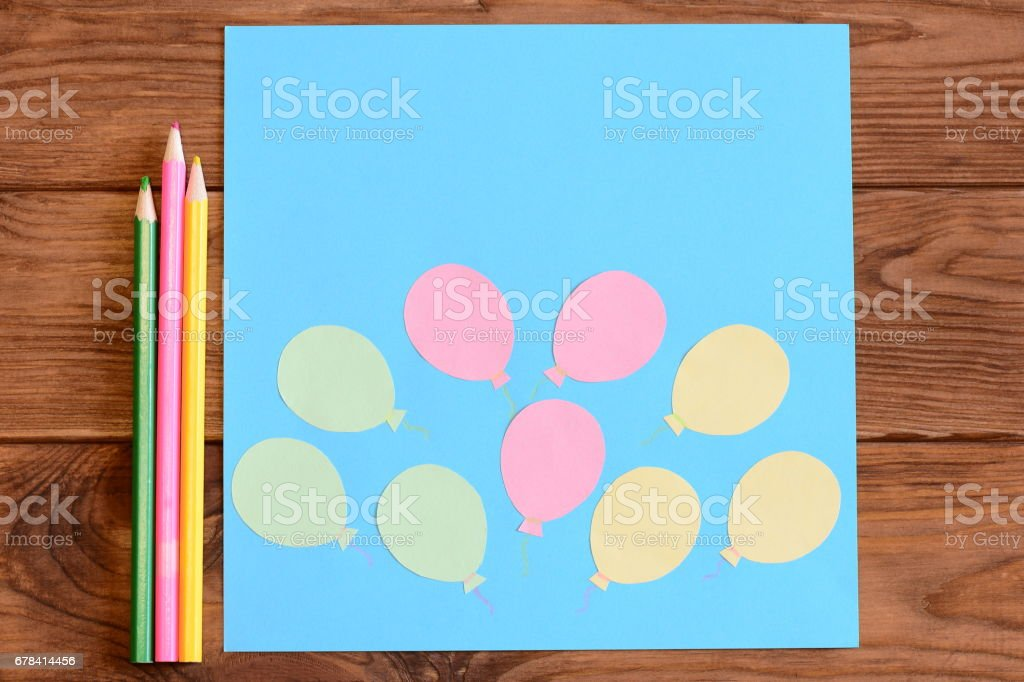 Making a card with paper air balloons. Step. Lesson for kids. Card with paper air balloons, colored pencils stock photo
