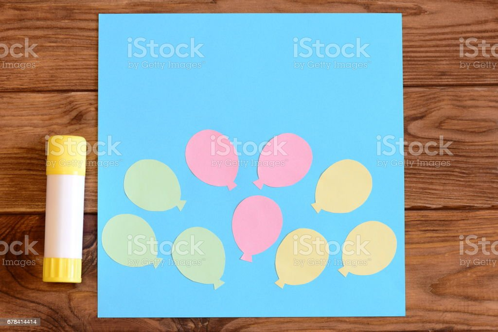 Making a card with paper air balloons. Step. Tutorial for kids. Card with paper air balloons, glue stick stock photo
