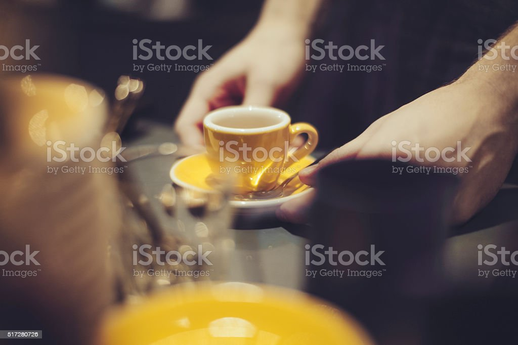 Making a coffee stock photo