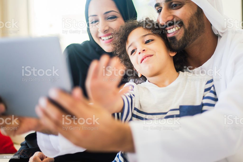Making a confernce call on a digital tablet. stock photo