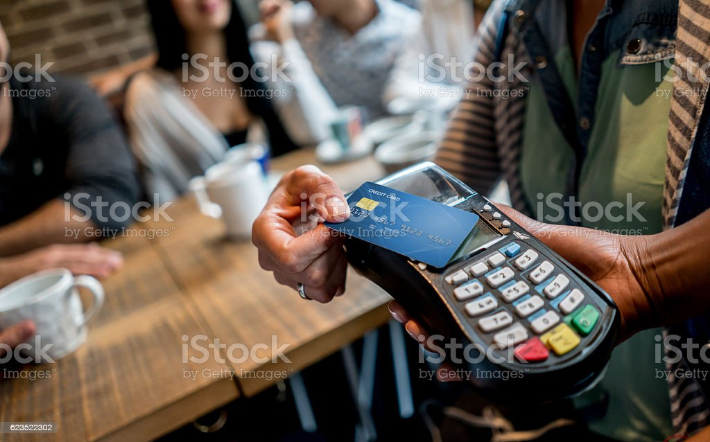 Making a contactless payment at a restaurant stock photo