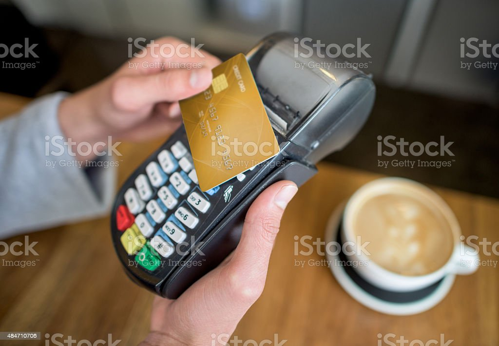Making a contactless payment at coffee shop stock photo
