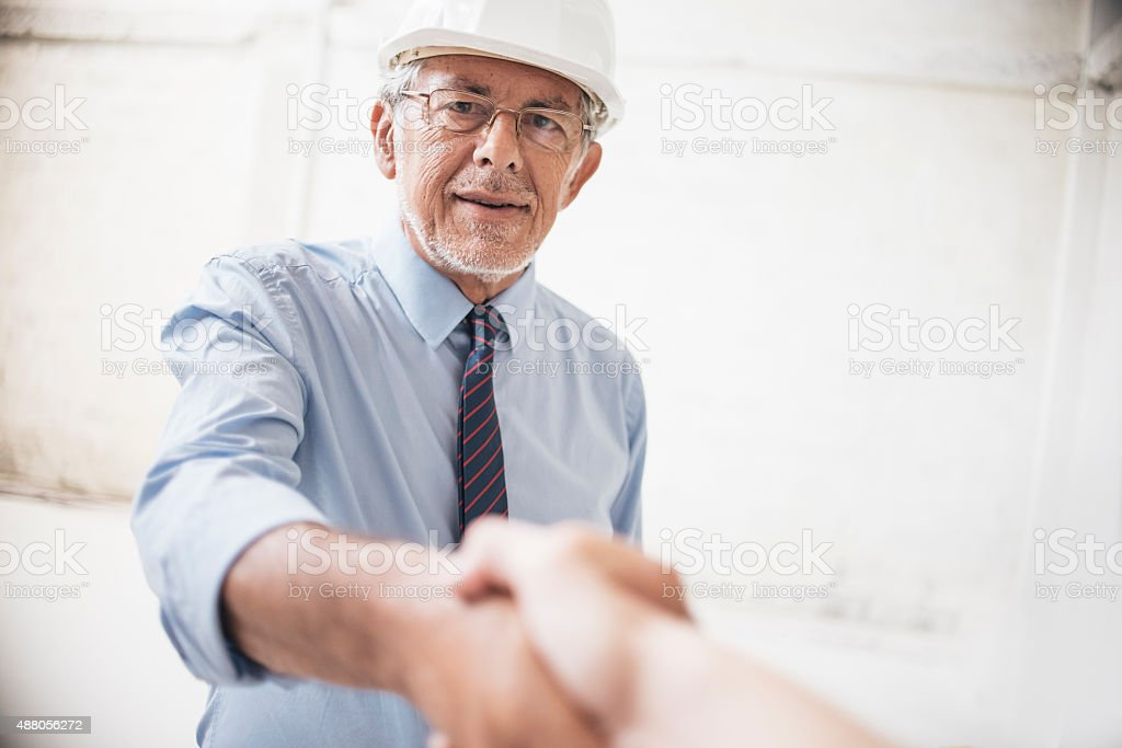 Making a deal on construction site stock photo