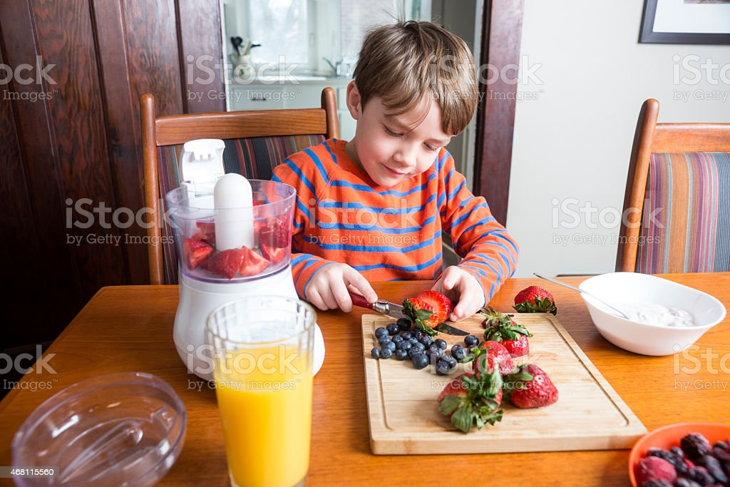 Making a delicious and nutritious fruit smoothie at home stock photo