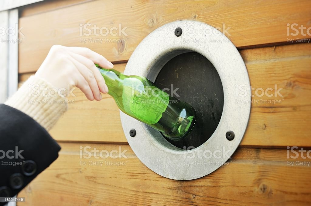 Making a Deposit at the Bottle Bank stock photo