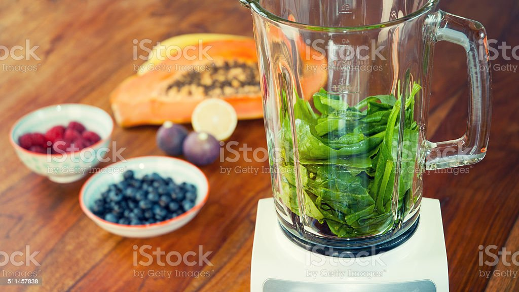 Making a green smoothie stock photo