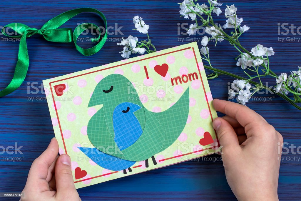 Making a greeting card for Mother's Day. Step 9 stock photo