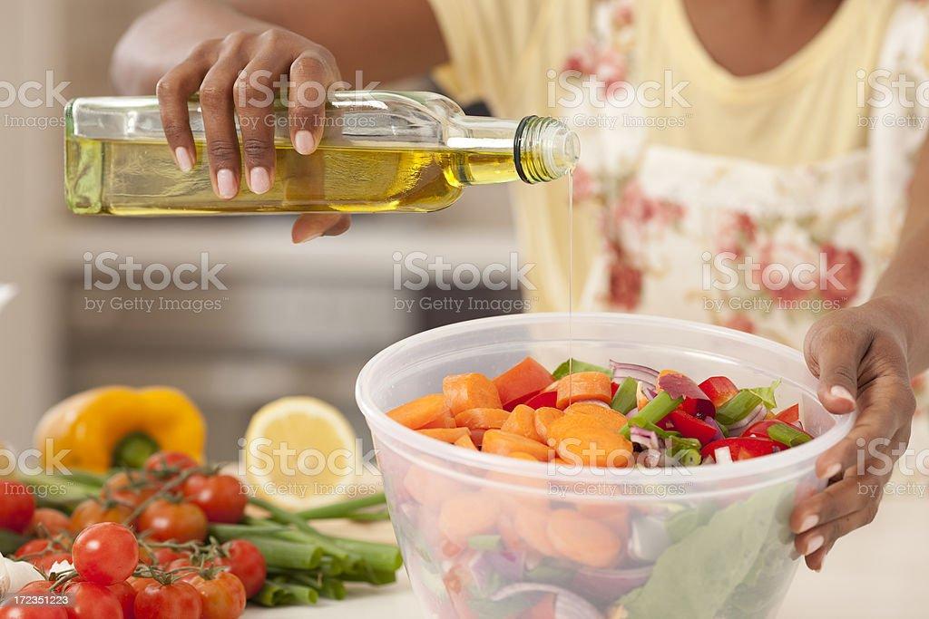Making a healthy fresh salad. royalty-free stock photo
