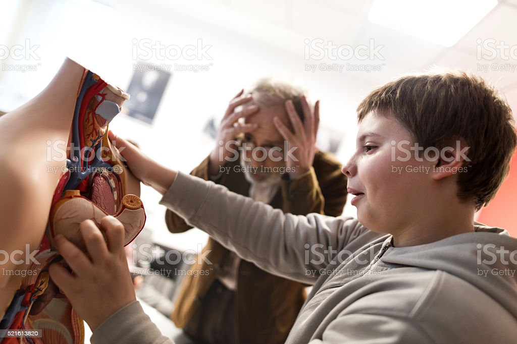 Making a mistake on anatomy class! stock photo