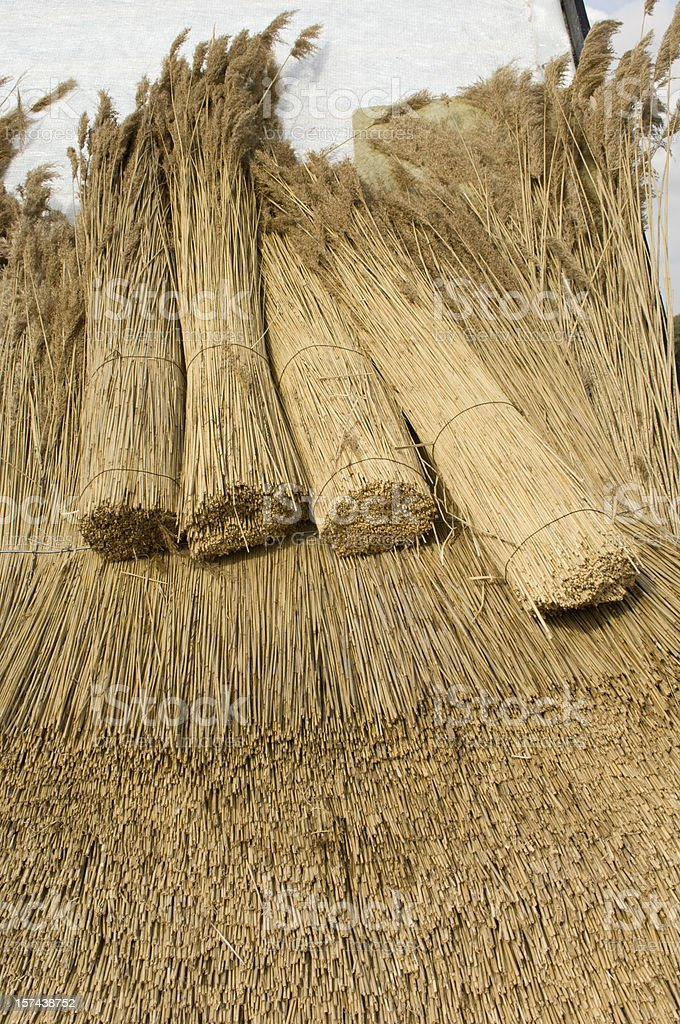 Making a New Traditional Style Thatched Roof royalty-free stock photo