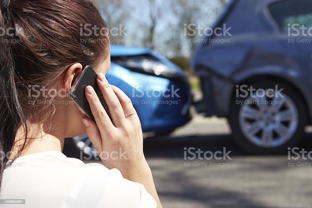 Making a phone call after a traffic accident stock photo