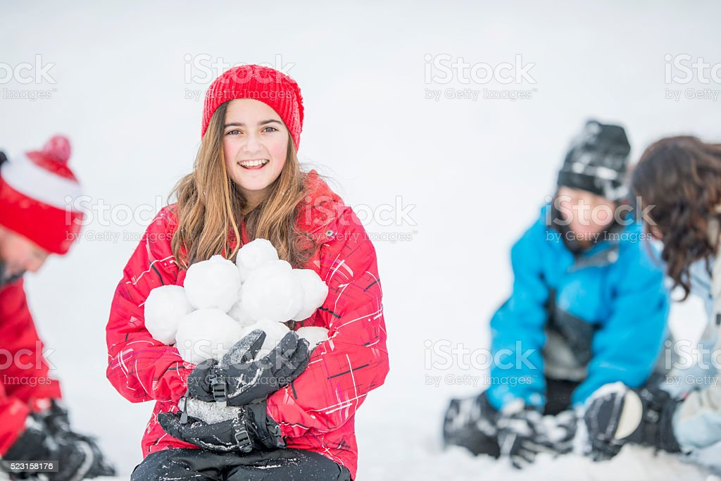 Making a Pile of Snowballs stock photo