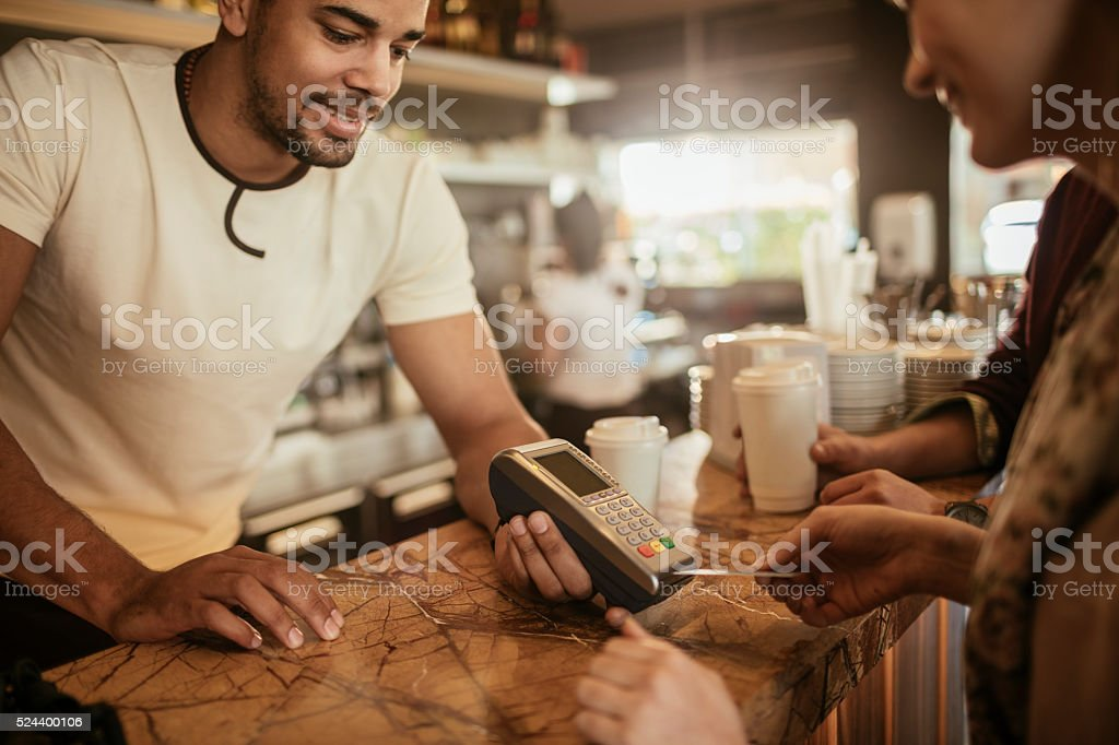 Making a sale at cafe stock photo