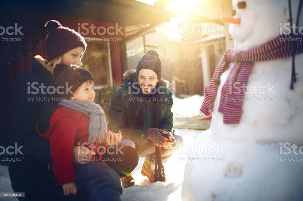 Making a snowman with my family stock photo