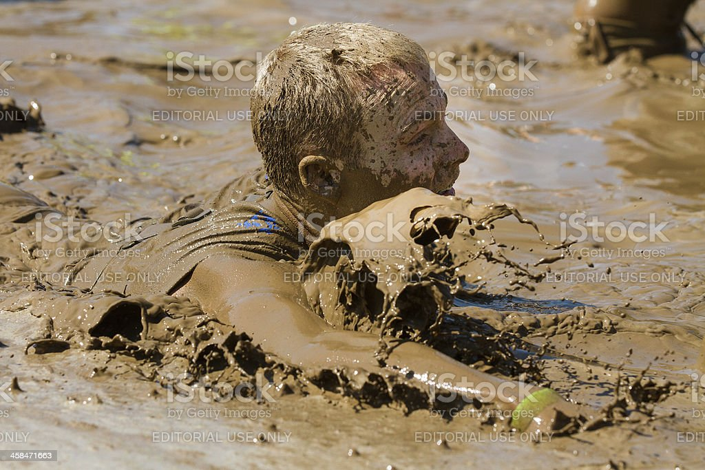 Making a spalsh in the mud pit stock photo