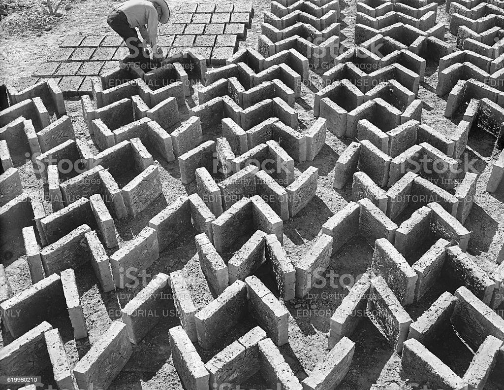 making adobe bricks stock photo