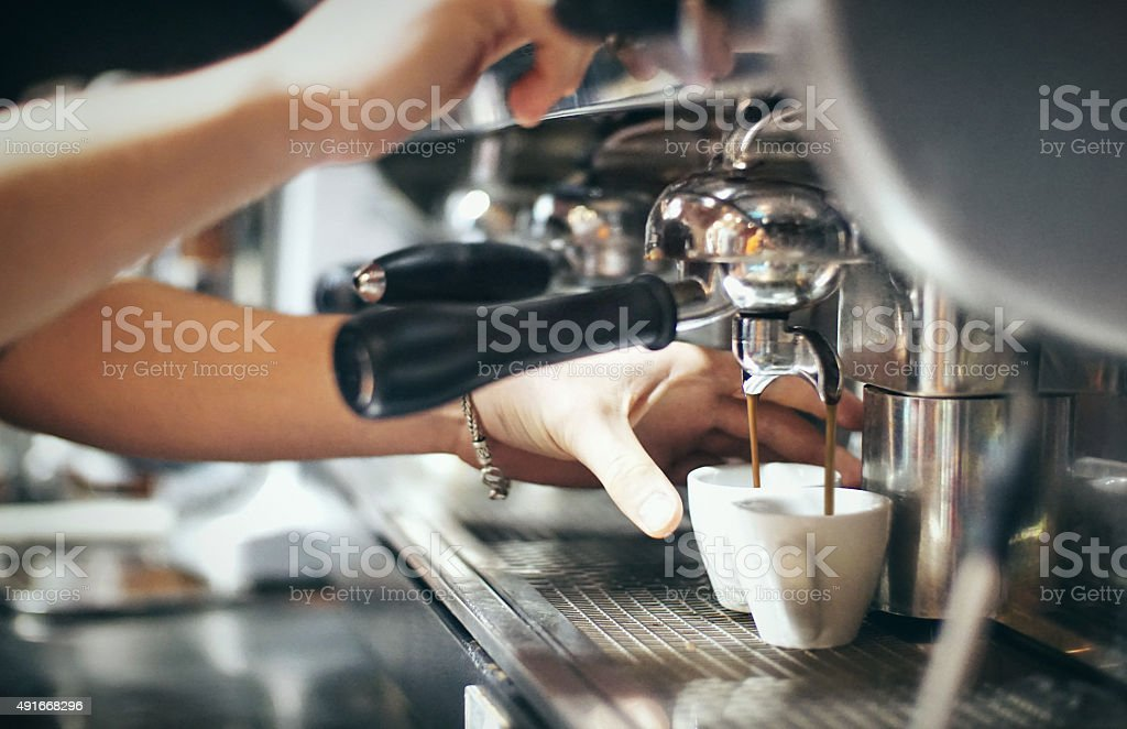 Making an espresso. stock photo