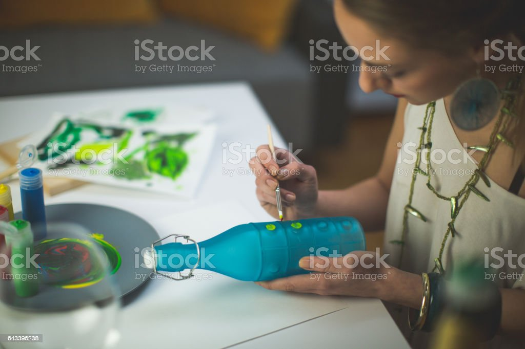 Making art on the bottle stock photo