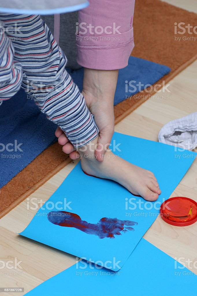 Making baby footprints on paper stock photo