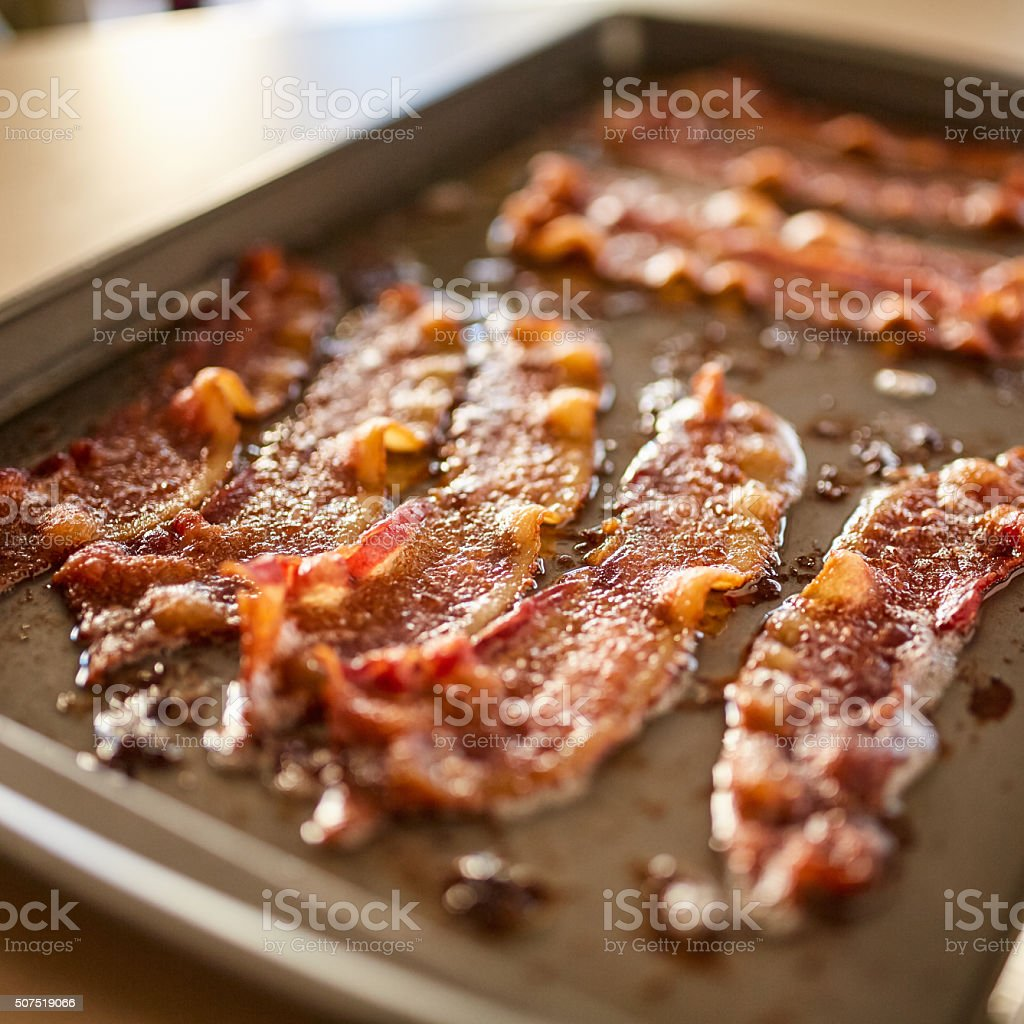 making bacon in oven kitchen hack stock photo